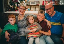 Louis Jackson (left) enjoying Christmas with his mum Sarah, dad Sam and his brother and sister.