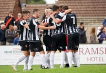Spennymoor Town's players celebrate after scoring.
