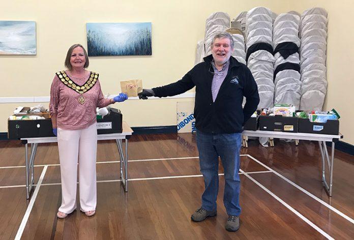 Spennymoor Mayor, Cllr Elizabeth Wood, handing £500 to Maurice Aspey, one of the St Paul's food bank volunteers.